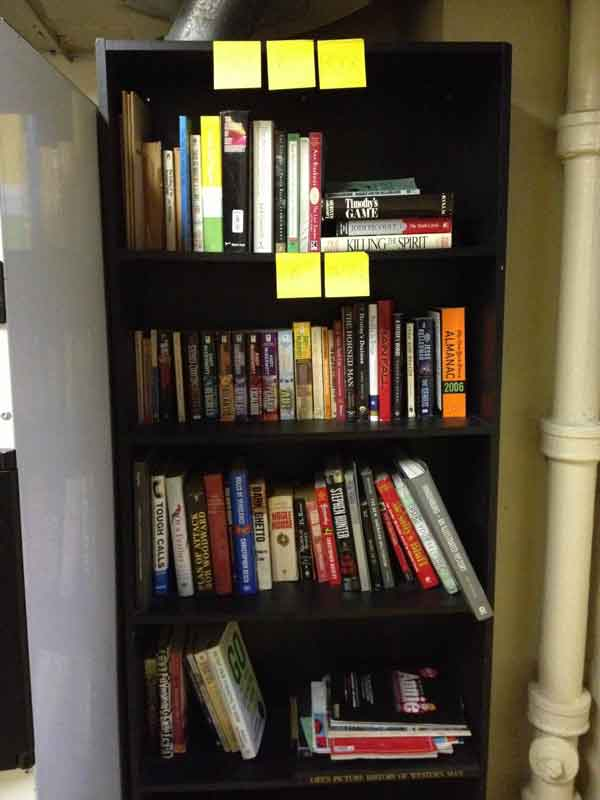 Jacquie Ottman's office book shelf