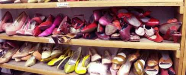 Cluttered Shoes on Closet Shelves