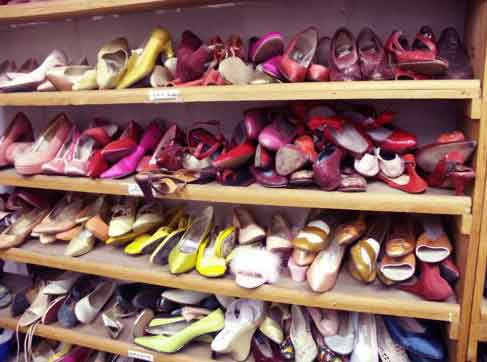 High heels and pumps in disarray in the closet  Declutter your home