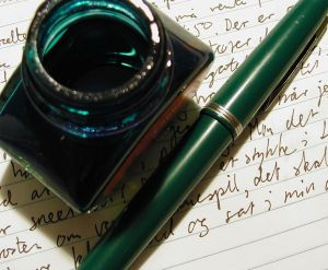 Green fountain pen with refillable ink