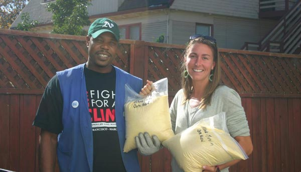 Dana Frasz delivering food to James at St. Vincent de Paul (Image Credit: Food Shift)