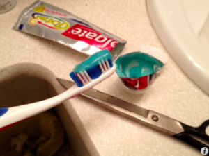Emptying the tube of Colgate