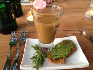 First course: Heirloom tomato gazpacho with carrot top and fennel frond pesto on French bread crostini with pickled kale stems (Image: Bill Gordon)(Image: Bill Gordon)