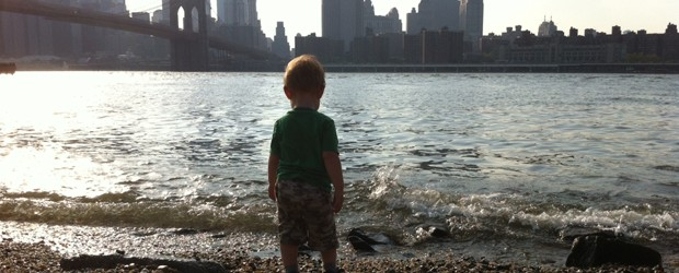 Child overlooking East River from Brooklyn towards Manhattan