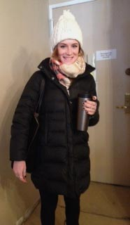 Erin arriving for work with reusable Starbucks coffee mug in hand. (Image: J. Ottman)