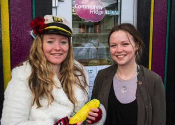 Esther Deeks and Anna Francis, resilience officer of Frome Town Council, celebrate the launch of the Frome Community Fridge, a project designed to cut down on food waste, while benefitting the needy.