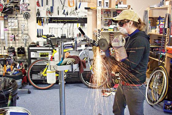 Woman fixing bike in NYC