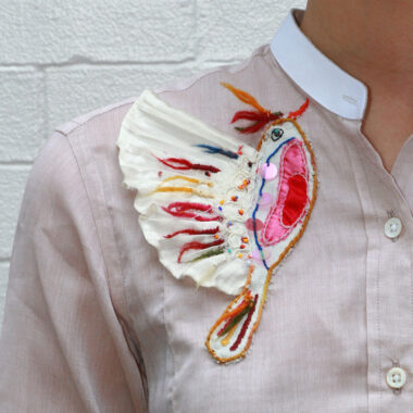 Visible Mending Bird Embroidered On a Shirt By Jussara Lee
